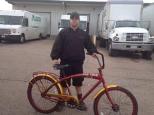 Greg Cushman receives his Fat Tire bike