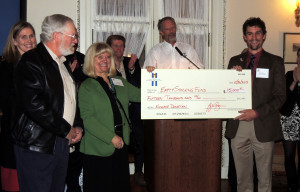 ACBF presents a $15,000 check to the Empty Stocking Fund