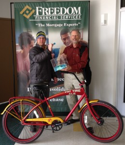 Travis Flett pulls winning door prize ticket for Fat Tire bike