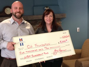 Matt Favier presents ACBF check to Jennifer Fisher at UCCS