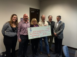 ACBF Scholarship Fund check presentation