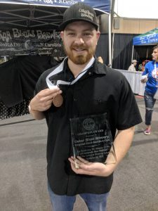 Conner Finley with Oskar Blues Champion Award