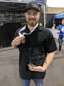 Conner Finley with Oskar Blues Champion Award